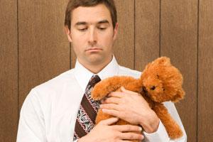 Man-holds-teddy-bear